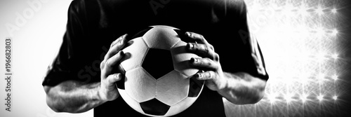 Fotografie, Tablou  Composite image of mid section of football player in black