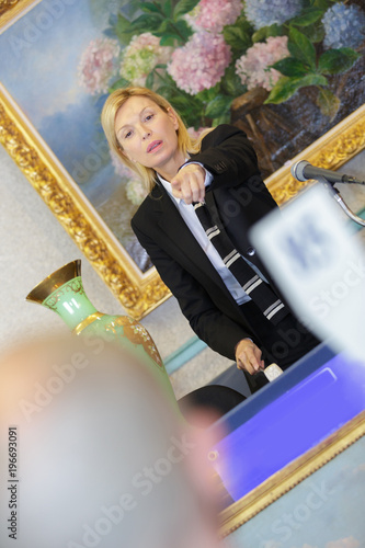 auctioneer pointing finger at bidder Canvas Print