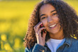 Mixed Race African American Girl Teenager Talking on Cell Phone