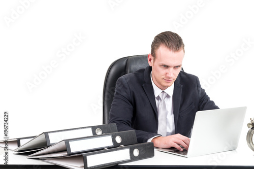 Fototapety, obrazy: Businessman manager working on notebook computer and business document isolated on white background