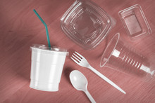 A Group Of Plastic Disposable Tableware On The Table