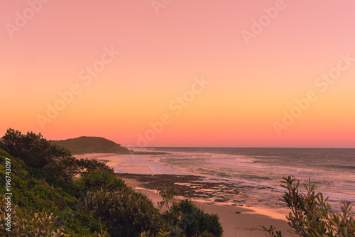 The Pinky sunset in summer time on the beach in Ballina with ocean view and hill Fototapeta