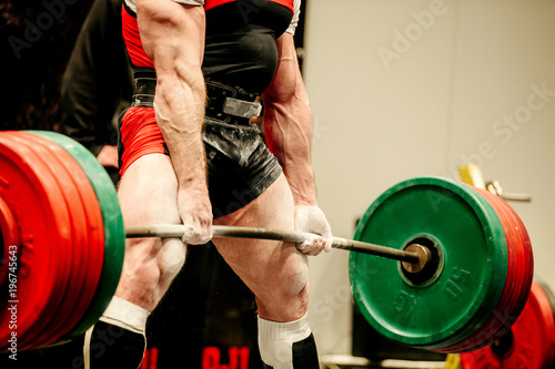 Fotografiet  powerlifter heavy weight barbell exercise deadlift in powerlifting
