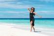 Happy woman on Maldives. White sand beach