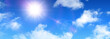 Sunny background, blue sky, clouds and sun