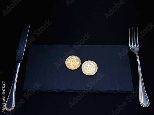 Bitcoins at breakfast, lunch and dinner  Bitcoin on stone plate with