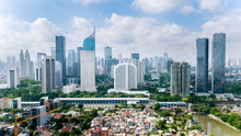 Panoramic View Of Jakarta Cityscape With Residential Houses, Modern Office And Apartment Buildings
