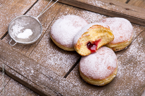 Foto Traditional Polish donuts on wooden background