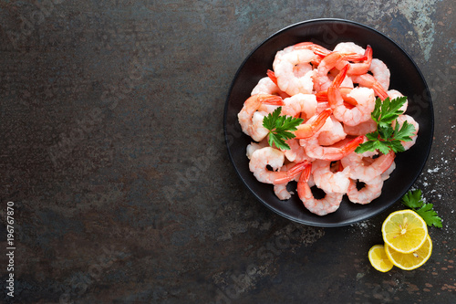 Prawns on plate. Shrimps, prawns. Seafood. Top view. Dark background