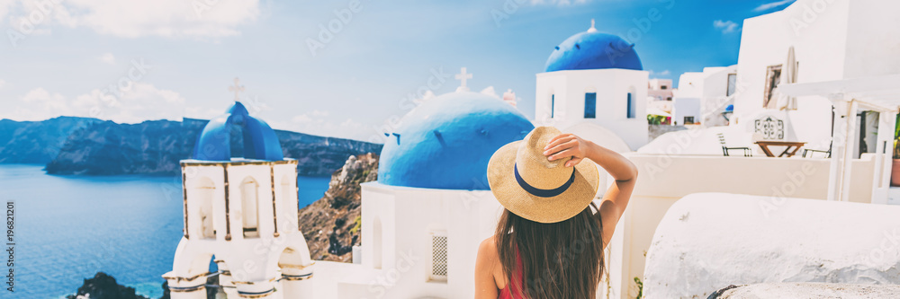 Fototapeta Summer travel tourist visiting Oia, Santorini, Europe vacation destination. Luxury holiday woman walking in city. Banner panorama.