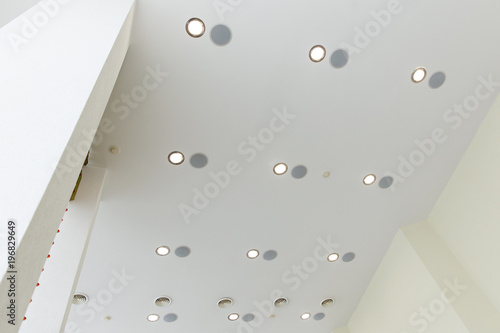 Modern layered ceiling with embedded lights and stretched ceiling inlay