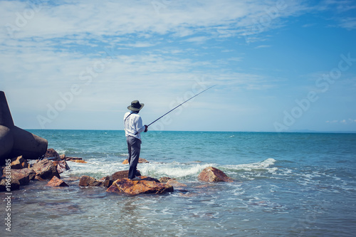 Foto auf Gartenposter Sansibar fisherman fishing in the beach sunny day