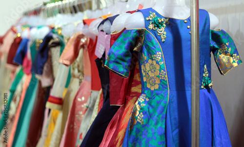 dab725102d Closeup of Indian woman dress hung in display of retail shop - Buy ...