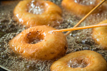 Closeup Of Frying Tasty And Homemade Donuts On Fresh Oil