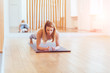 Fitness training sporty middle aged woman doing plank exercise in home or yoga class concept exercising workout aerobic