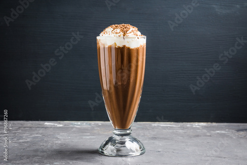 Chocolate milkshake on the rustic background. Selective focus.