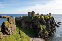 Dunnottar Castle Is A Ruined Medieval Fortress Located Upon A Rocky Headland On The North-east Coast Of Scotland