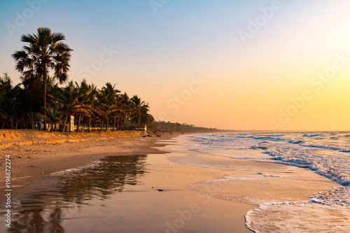 Photo  Enjoying the sunset on an idyllic beach in the Gambia, West Africa