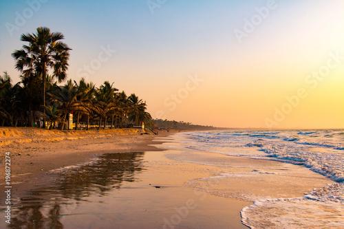 Obraz Enjoying the sunset on an idyllic beach in the Gambia, West Africa - fototapety do salonu