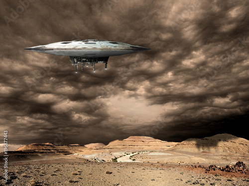 a large saucer shaped mothership hovers over a barren world Poster