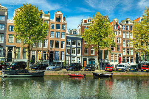 Photo  Fantastic traditional buildings and water canal in Amsterdam, Netherlands, Europ