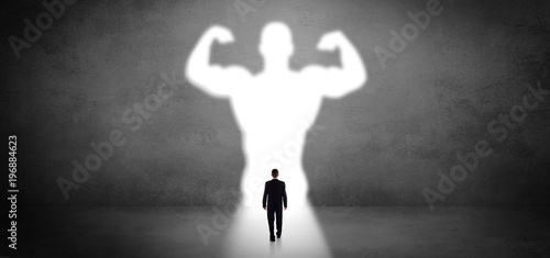 Fotografia Businessman standing in front of a strong hero vision
