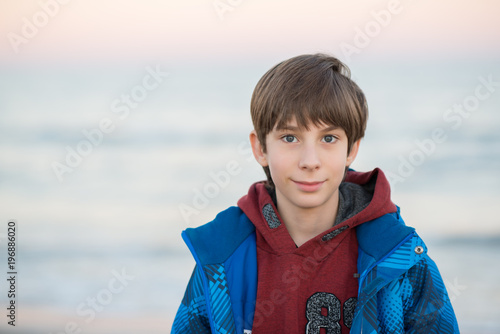 f9686a72c Young boy posing at the winter beach. Cute smiling happy 11 years ...