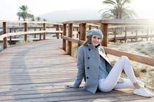 Dreamy Woman Sitting On Boardwalk