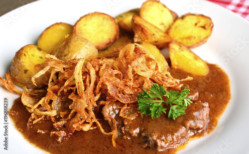 onion-topped roast beef with gravy is the favorite dish in Austria. (German name is Zwiebelrostbraten)