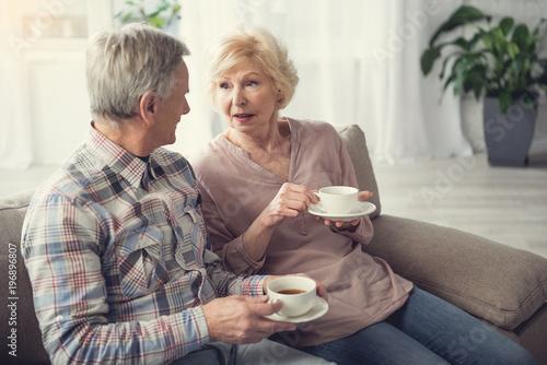 Láminas  Tranquil elderly man and woman enjoying morning breakfast