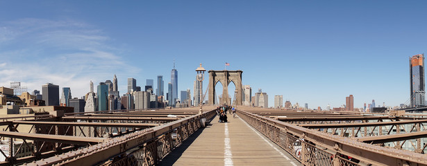 Brooklyn Bridge view with the flag of the United States in New York City.