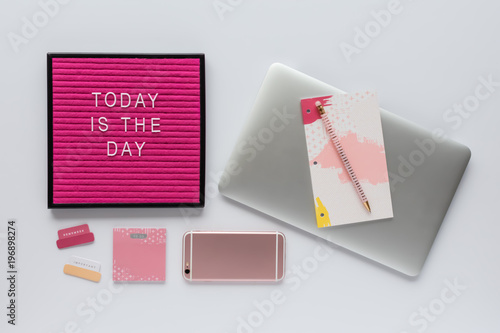 Desk Work Space With Laptop Computer, Mobile Phone, Motivational Letter  Board Quote And Pink