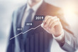Leinwanddruck Bild - Growth in 2019 year concept. Businessman plan growth and increase of positive indicators in his business.