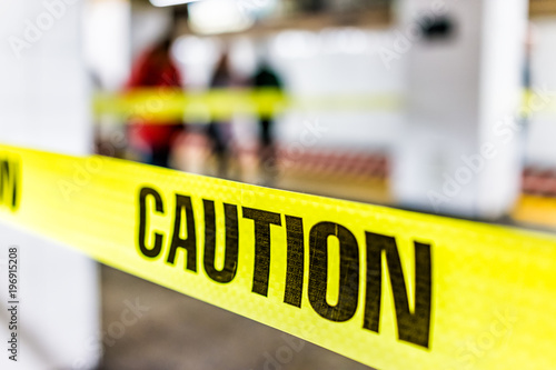 Caution tape sign in underground transit empty large platform in New York City N Wallpaper Mural
