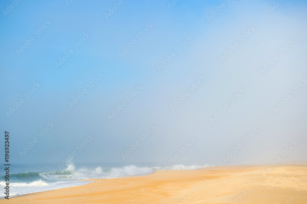 Picturesque scenery seascape of foggy misty abandoned wild beach. Art beautiful landscape of deserted cost with ocean waves. Colorful nature paysage. Desolate mediterranean costline. Fairy tale view.