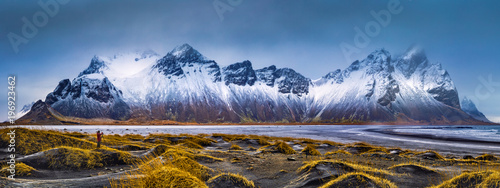 Tuinposter Bergen Vestrahorn mountain range and Stokksnes beach panorama, near Hofn, Iceland. An unidentifiable photographer captures the scenery.