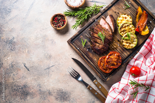 Spoed Foto op Canvas Grill / Barbecue Barbecue dish. Beef steak and grilled vegetables top view.