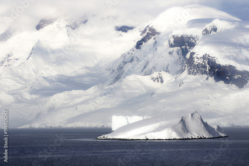 Deurstickers Antarctica Antarctica on a Sunny day- Antarctic Peninsula - Huge Icebergs and blue sky.