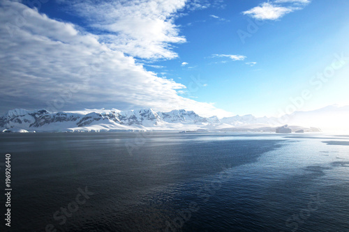 Foto op Canvas Antarctica Antarctica on a Sunny day- Antarctic Peninsula - Huge Icebergs and blue sky.
