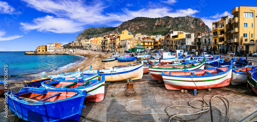 Traditional fishing village Aspra with colorful boats in Sicily. Italy