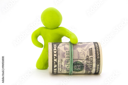Photo  Lime green plasticine characters and ready cash dollars