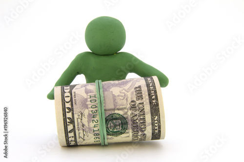 Green plasticine characters and ready cash dollars Canvas Print