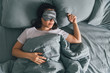 canvas print picture - woman sleep in eye patch in grey bed. copy space