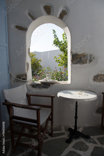 A small table and a chair on a small balcony in Amorgos, it's just what you need Canvas Print