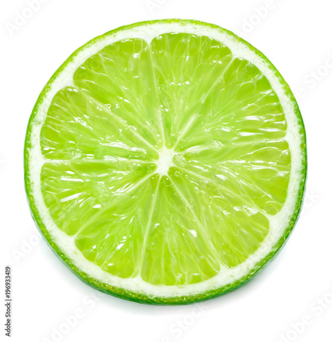 Valokuvatapetti close-up view of single slice of lime isolated on white background