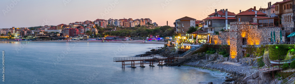 Fototapety, obrazy: Seaside landscape, panorama, banner - view of the embankment with fortress wall during sunset in the city of Sozopol on the Black Sea coast in Bulgaria.