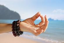 Woman Hand Yoga And Meditation On Summer Beach Background