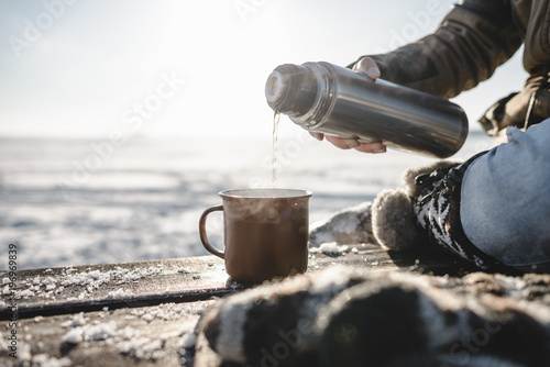 Pouring the tea from the thermos