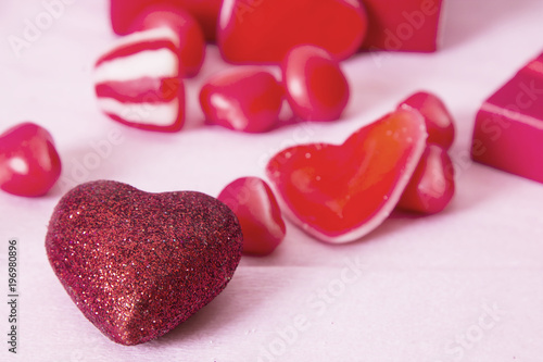 Poster  gift box with heart candies on pink background
