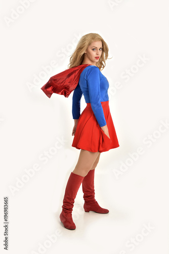 Photo  full length portrait of pretty girl wearing super hero costume, standing pose, isolated on white studio background